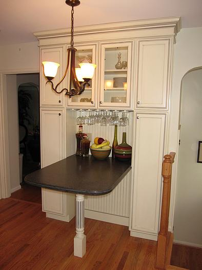 Seating and storage in remodeled kitchen in College Hill, Cincinnati, Ohio